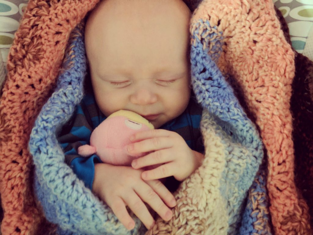 sleeping baby in a baby blanket